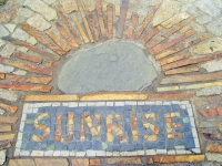 Sunrise Inc. walkway to office Sign